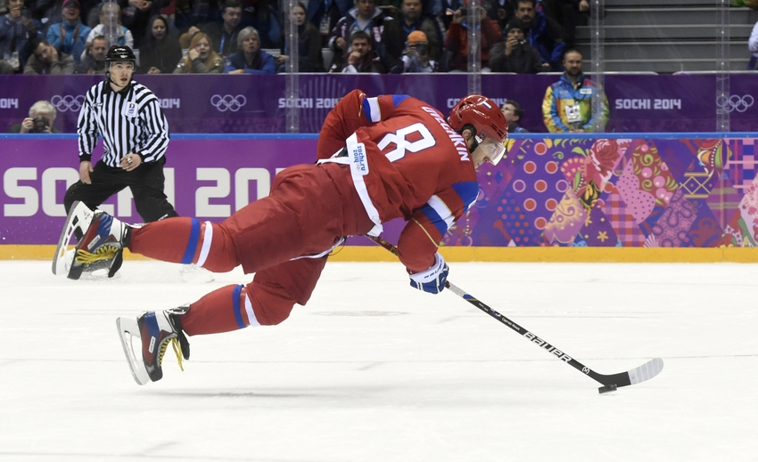 Feb 18, 2014; Sochi, RUSSIA; Russia forward Alex Ovechkin (8) loses his balance on a breakaway against Norway in a men's ice hockey playoffs qualifications game during the Sochi 2014 Olympic Winter Games at Bolshoy Ice Dome. Mandatory Credit: Scott Rovak-USA TODAY Sports