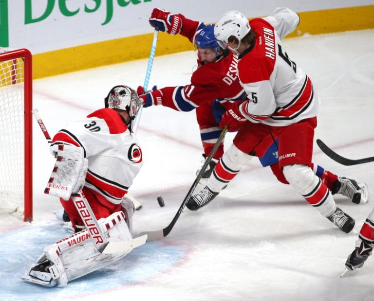 Cam-ward-david-desharnais-noah-hanifin-nhl-carolina-hurricanes-montreal-canadiens-768x0
