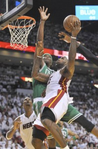 LeBron James fends off J.O for a layup