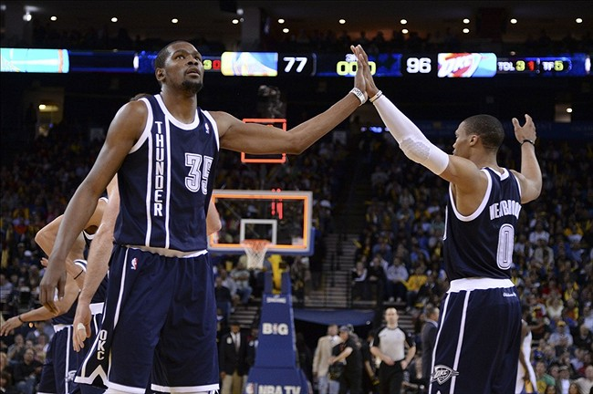 April 11, 2013; Oakland, CA, USA; Oklahoma City Thunder small forward Kevin Durant (35) celebrates with point guard Russell Westbrook (0) after the third quarter against the Golden State Warriors at Oracle Arena. The City Thunder defeated the Warriors 116-97. Mandatory Credit: Kyle Terada-USA TODAY Sports