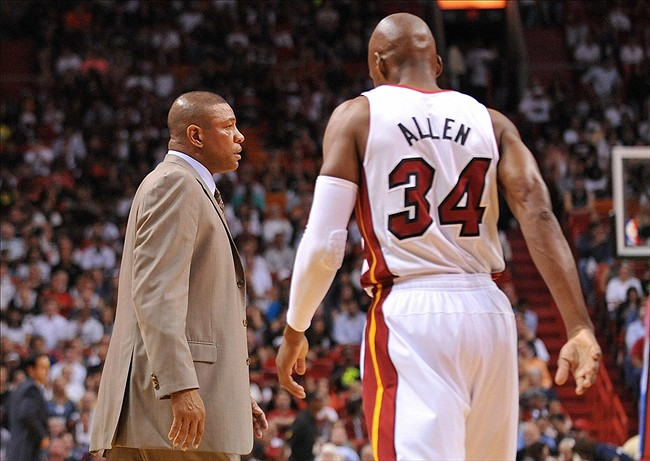 Apr 12, 2013; Miami, FL, USA; Miami Heat shooting guard Ray Allen (right) walks past Boston Celtics head coach Doc Rivers (left) during their game at American Airlines Arena. Mandatory Credit: Steve Mitchell-USA TODAY Sports