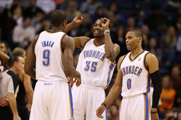 Feb. 10, 2013; Phoenix, AZ, USA: Oklahoma City Thunder small forward Kevin Durant (35), point guard Russell Westbrook (0) and power forward Serge Ibaka (9) against the Phoenix Suns at the US Airways Center. Mandatory Credit: Mark J. Rebilas-USA TODAY Sports