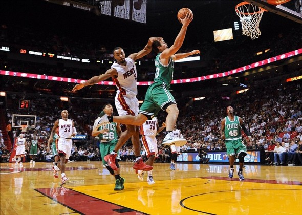 Nov 9, 2013; Miami, FL, USA; Miami Heat power forward Rashard Lewis (9) fouls Boston Celtics power forward Kris Humphries (43) during the first half at American Airlines Arena. Mandatory Credit: Steve Mitchell-USA TODAY Sports
