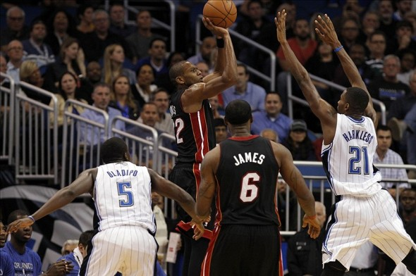 Nov 20, 2013; Orlando, FL, USA; Miami Heat small forward James Jones (22) shoots a three pointer against the Orlando Magic during the second half at Amway Center. Miami Heat defeated the Orlando Magic 120-92. Mandatory Credit: Kim Klement-USA TODAY Sports