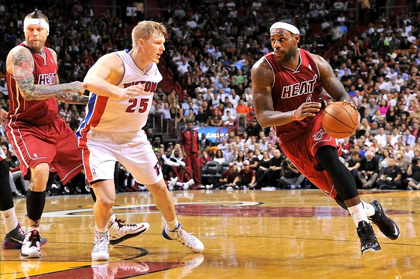 Dec 3, 2013; Miami, FL, USA; Miami Heat small forward LeBron James (6) dribbles the ball as Detroit Pistons small forward Kyle Singler (25) defends during the second half at American Airlines Arena. Mandatory Credit: Steve Mitchell-USA TODAY Sports