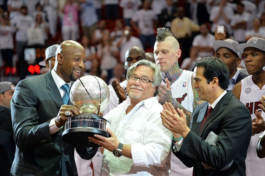 Jun 3, 2013; Miami, FL, USA; Miami Heat former center Alonzo Mourning (left), Micky Arison (center) and head coach Erik Spoelstra (right) celebrate with the trophy after game 7 of the 2013 NBA Eastern Conference Finals at American Airlines Arena. The Heat defeated the Pacers 99-76 to win the series four games to three. Mandatory Credit: Steve Mitchell- USA TODAY Sports