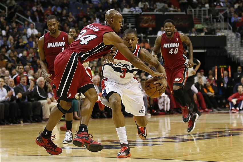 Jan 15, 2014; Washington, DC, USA; Miami Heat shooting guard Ray Allen (34) fouls Washington Wizards shooting guard Bradley Beal (3) while dribbling the ball in the second quarter at Verizon Center. Mandatory Credit: Geoff Burke-USA TODAY Sports