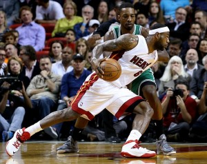 Jan 21, 2014; Miami, FL, USA; Miami Heat small forward LeBron James (6) dribbles the ball around Boston Celtics small forward Jeff Green (8) in the first half at American Airlines Arena. Mandatory Credit: Robert Mayer-USA TODAY Sports