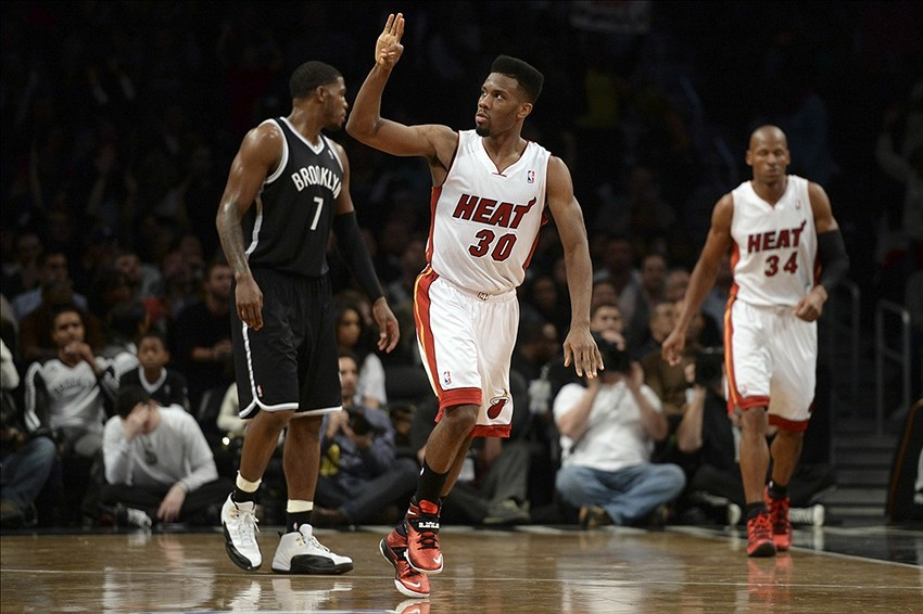 Jan 10, 2014; Brooklyn, NY, USA; Miami Heat point guard Norris Cole (30) reacts after making a three point shot against the Brooklyn Nets during the second half at Barclays Center. The Brooklyn Nets won the game 104-95 in double overtime. Mandatory Credit: Joe Camporeale-USA TODAY Sports