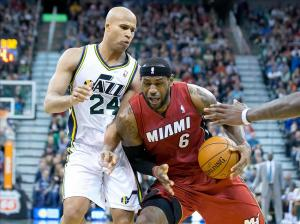 Feb 8, 2014; Salt Lake City, UT, USA; Miami Heat small forward LeBron James (6) dribbles the ball in front of Utah Jazz small forward Richard Jefferson (24) during the first half at EnergySolutions Arena. Mandatory Credit: Russ Isabella-USA TODAY Sports