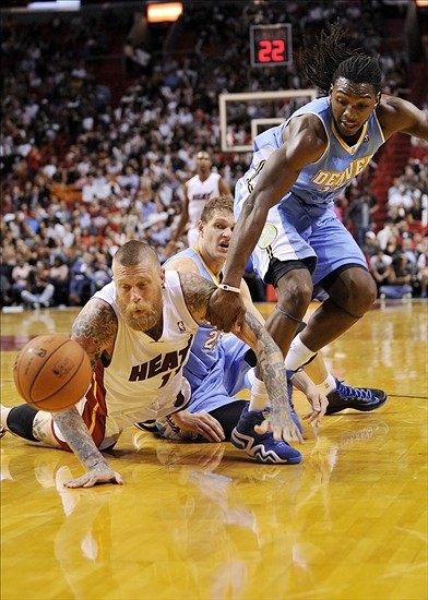 Mar 14, 2014; Miami, FL, USA; Miami Heat forward Chris Andersen (11) and Denver Nuggets forward Kenneth Faried (35) chase a loose ball during the second half at American Airlines Arena. Mandatory Credit: Steve Mitchell-USA TODAY Sports