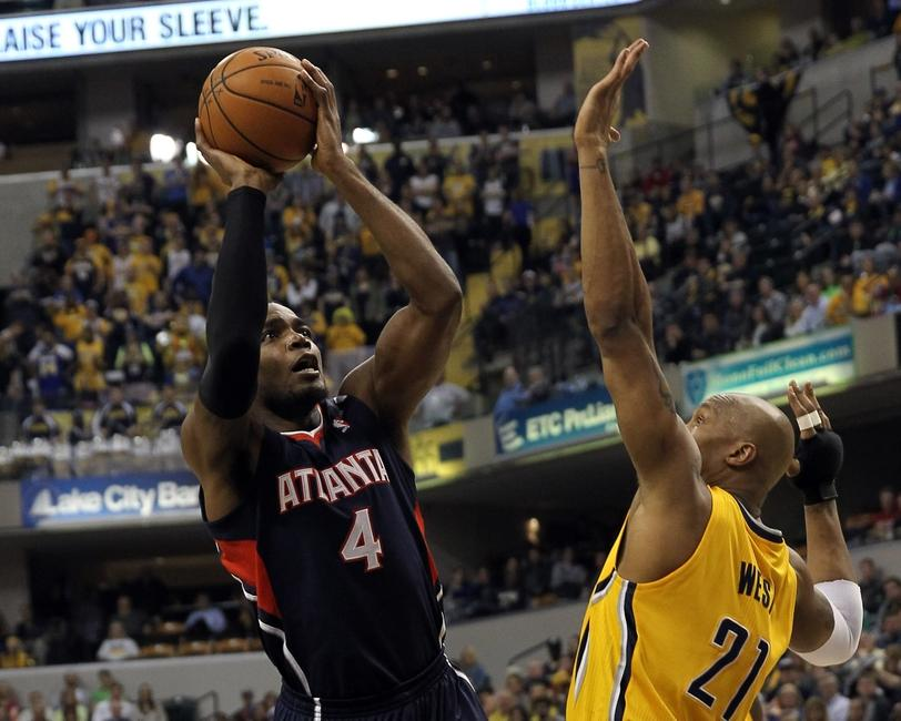 Apr 6, 2014; Indianapolis, IN, USA; Atlanta Hawks forward Paul Millsap (4) shoots over Indiana Pacers forward David West (21) during the first quarter at Bankers Life Fieldhouse. Mandatory Credit: Pat Lovell-USA TODAY Sports