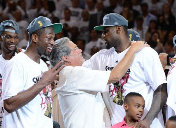 Jun 21, 2012; Miami, FL, USA; Miami Heat owner Micky Arison (left) and LeBron James (right) celebrate after winning the NBA championship in game five of the 2012 NBA Finals at the American Airlines Arena. The Heat defeated the Oklahoma City Thunder 121-106. Mandatory Credit: Steve Mitchell-USA TODAY Sports