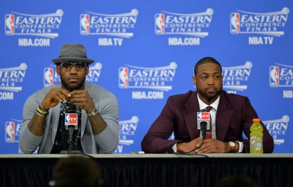 May 24, 2014; Miami, FL, USA; Miami Heat forward LeBron James and guard Dwyane Wade talks with the media following the Heat 99-87 victory over the Indiana Pacers in game three of the Eastern Conference Finals of the 2014 NBA Playoffs at American Airlines Arena. Mandatory Credit: Steve Mitchell-USA TODAY Sports