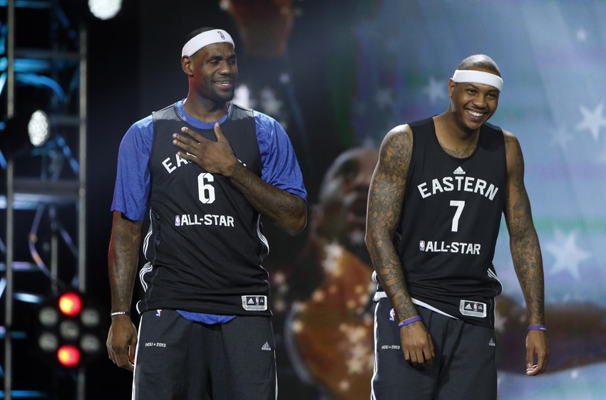 Feb 16, 2013; Houston, TX, USA; Eastern Conference forward LeBron James (6) of the Miami Heat and forward Carmelo Anthony (7) of the New York Knicks react as they are introduced during practice for the 2013 NBA all star game at the George R. Brown Convention Center. Mandatory Credit: Brett Davis-USA TODAY Sports