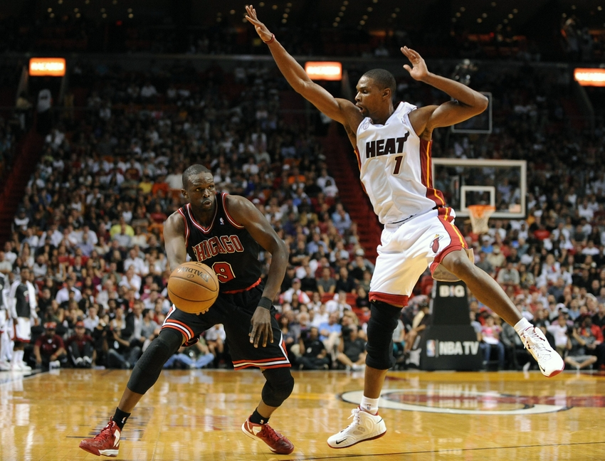 Jan 4, 2013; Miami, FL, USA; Chicago Bulls small forward Luol Deng (9) is pressured by Miami Heat center Chris Bosh (1) during the first half at American Airlines Arena. Mandatory Credit: Steve Mitchell-USA TODAY Sports