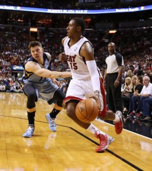 Mar 21, 2014; Miami, FL, USA; Miami Heat guard Mario Chalmers (15) dribbles the ball past Memphis Grizzlies forward Mike Miller (13) in the second half at American Airlines Arena. The Heat won 91-88. Mandatory Credit: Robert Mayer-USA TODAY Sports