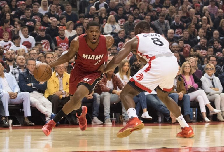 Bismack-biyombo-joe-johnson-nba-playoffs-miami-heat-toronto-raptors-768x521
