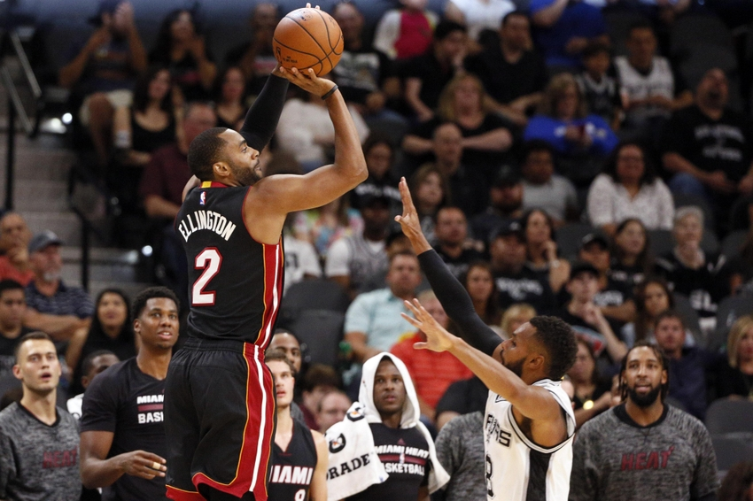 Oct 14, 2016; San Antonio, TX, USA; Miami Heat shooting guard Wayne Ellington (2) shoots the ball over San Antonio Spurs point guard Patty Mills (8, right) during the first half at AT&T Center. Mandatory Credit: Soobum Im-USA TODAY Sports