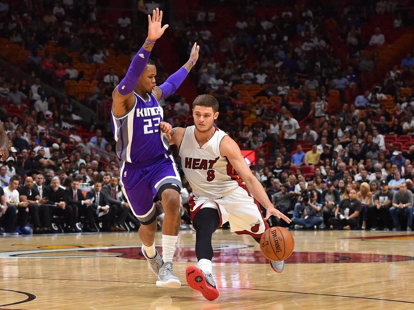 Nov 1, 2016; Miami, FL, USA; Miami Heat guard Tyler Johnson (8) dribbles the ball around Sacramento Kings guard Ben McLemore (23) during the second half at American Airlines Arena. The Miami Heat defeat the Sacramento Kings 108-96 in overtime. Mandatory Credit: Jasen Vinlove-USA TODAY Sports