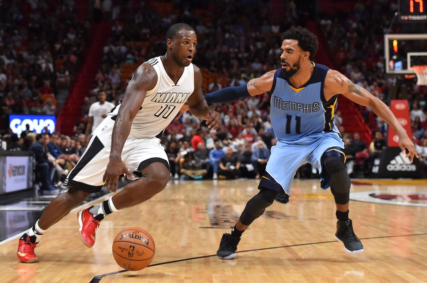 Nov 26, 2016; Miami, FL, USA; Miami Heat guard Dion Waiters (11) drives the ball around Memphis Grizzlies guard Mike Conley (11) during the second half at American Airlines Arena. The Memphis Grizzlies defeat the Miami Heat 110-107. Mandatory Credit: Jasen Vinlove-USA TODAY Sports