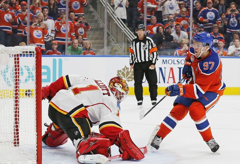 Oct 12, 2016; Edmonton, Alberta, CAN; Edmonton Oilers forward Connor McDavid (97) scores on a penalty shot in the second period against the Calgary Flames goaltender Brian Elliott (1) at Rogers Place. Mandatory Credit: Perry Nelson-USA TODAY Sports