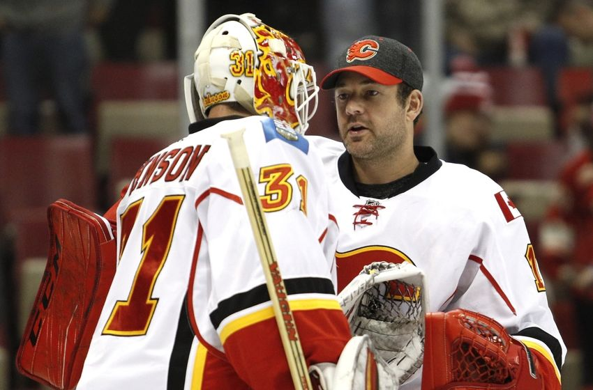 Nov 20, 2016; Detroit, MI, USA; Calgary Flames goalie Brian Elliott (right) shakes hands with goalie Chad Johnson (31) after the game against the Detroit Red Wings at Joe Louis Arena. Flames won 3-2. Mandatory Credit: Raj Mehta-USA TODAY Sports