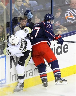 Sep 15, 2013; Columbus, OH, USA; Columbus Blue Jackets defenseman Ryan Murray (27) body checks Pittsburgh Penguins forward Andrew Ebbett (25) during the 3rd period of the game at Nationwide Arena. Murray scored the game winning goal during the overtime period against the Pittsburgh Penguins. Mandatory Credit: Rob Leifheit-USA TODAY Sports