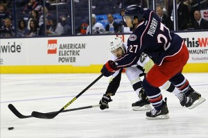 Sep 15, 2013; Columbus, OH, USA; Columbus Blue Jackets defenseman Ryan Murray (27) passes the puck in front of Pittsburgh Penguins forward Andrew Ebbett (25) during the 1st period at Nationwide Arena. Mandatory Credit: Rob Leifheit-USA TODAY Sports