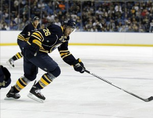 Sep 19, 2013; Buffalo, NY, USA; Buffalo Sabres left wing Thomas Vanek (26) races for the puck against the Carolina Hurricanes during the second period at First Niagara Center. Mandatory Credit: Kevin Hoffman-USA TODAY Sports