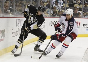 Sep 21, 2013; Pittsburgh, PA, USA; Pittsburgh Penguins defenseman Olli Maatta (3) and Columbus Blue Jackets center Brandon Dubinsky (17) battle to control the puck during the first period at the CONSOL Energy Center. Mandatory Credit: Charles LeClaire-USA TODAY Sports