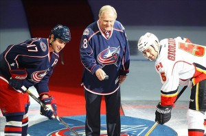Oct 4, 2013; Columbus, OH, USA; Jack Nicklaus drops the ceremonial face-off with Columbus Blue Jackets player Brandon Dubinsky (17) and Calgary Flames player Mark Giordano (5) before the game at Nationwide Arena. Mandatory Credit: Rob Leifheit-USA TODAY Sports