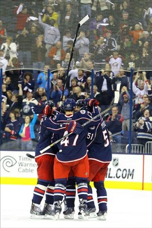 The Columbus Blue Jackets celebrate after scoring the third goal of the game on an empty net to seal the 3-1win against the Vancouver Canucks at Nationwide Arena. Photo By: Rob Leifheit-USA TODAY Sports