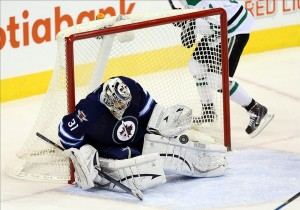 Dec 14, 2013; Winnipeg, Manitoba, CAN; Winnipeg Jets goalie Ondrej Pavelec (31) makes a save against the Dallas Stars during the second period at MTS Centre. Mandatory Credit: Bruce Fedyck-USA TODAY Sports
