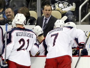 Nov 1, 2013; Pittsburgh, PA, USA; Columbus Blue Jackets head coach Todd Richards (center) gives instructions to his team during a time-out against the Pittsburgh Penguins during the third period at the CONSOL Energy Center. The Penguins won 4-2. Mandatory Credit: Charles LeClaire-USA TODAY Sports