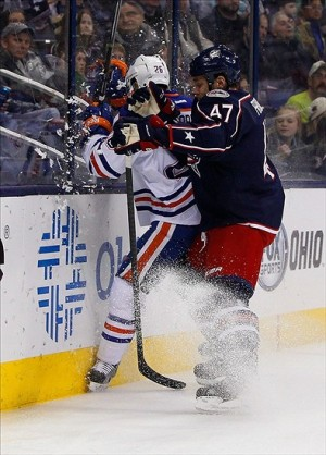 Nov 29, 2013; Columbus, OH, USA; Columbus Blue Jackets defenseman Dalton Prout (47) checks Edmonton Oilers center Mark Arcobello (26) into the end boards during the first period at Nationwide Arena. Mandatory Credit: Russell LaBounty-USA TODAY Sports
