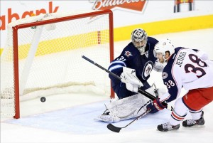 Jan 11, 2014; Winnipeg, Manitoba, CAN; Columbus Blue Jackets forward Boone Jenner (38) scores a penalty shot goal past Winnipeg Jets goalie Ondrej Pavelec (31) during the second period at MTS Centre. Mandatory Credit: Bruce Fedyck-USA TODAY Sports