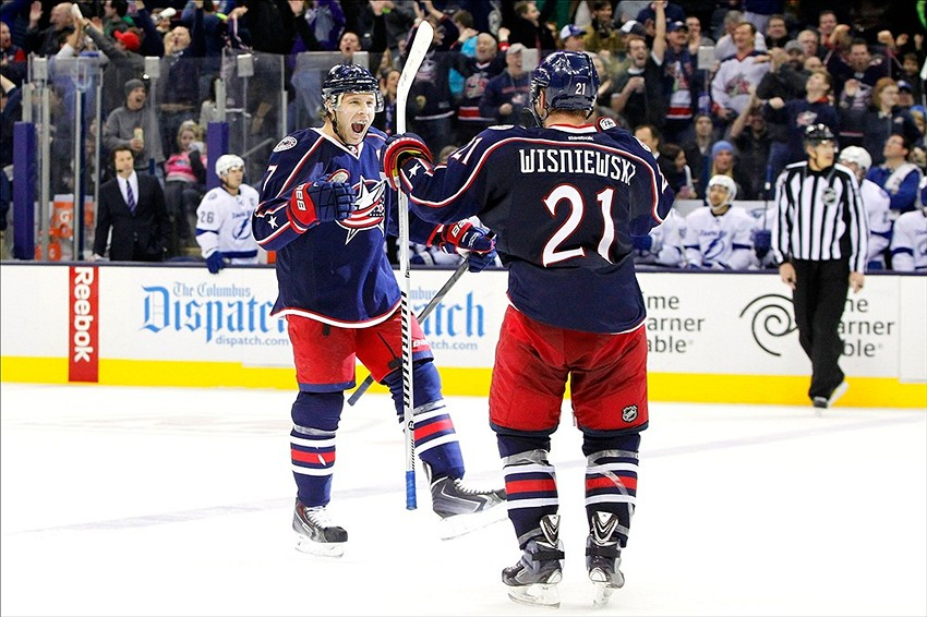 Jan 13, 2014; Columbus, OH, USA; Columbus Blue Jackets defenseman Jack Johnson (7) celebrates a goal during the third period against the Tampa Bay Lightning at Nationwide Arena. Columbus beat Tampa Bay 3-2. Mandatory Credit: Russell LaBounty-USA TODAY Sports