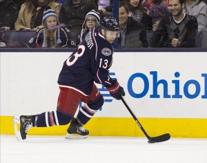Jan 28, 2014; Columbus, OH, USA; Columbus Blue Jackets right wing Cam Atkinson (13) carries the puck up the boards against the Ottawa Senators at Nationwide Arena. The Senators won the game 3-2. Mandatory Credit: Greg Bartram-USA TODAY Sports