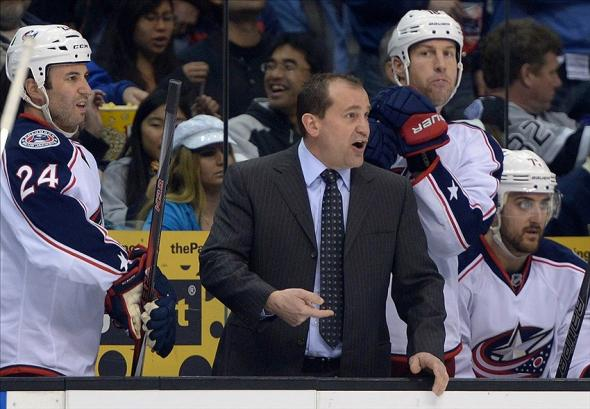Feb 6, 2014; Los Angeles, CA, USA; Columbus Blue Jackets coach Todd Richards (right) and center Derek MacKenzie (24) react in the second period against the Los Angeles Kings at Staples Center. Mandatory Credit: Kirby Lee-USA TODAY Sports