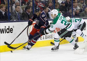 Mar 4, 2014; Columbus, OH, USA; Columbus Blue Jackets right wing Marian Gaborik (10) skates with the puck as Dallas Stars center Cody Eakin (20) reaches for the puck during the first period at Nationwide Arena. Mandatory Credit: Russell LaBounty-USA TODAY Sports