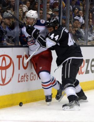 Feb 6, 2014; Los Angeles, CA, USA; Los Angeles Kings defenseman Robyn Regehyr (44) checks Columbus Blue Jackets defenseman James Wisniewski (21) into the boards in the second period at Staples Center. Mandatory Credit: Kirby Lee-USA TODAY Sports