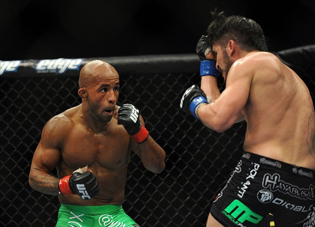 June 8, 2012; Sunrise, FL, USA; Demetrious Johnson (left) fights against Ian McCall (right) during their UFC bout at BankAtlantic Center. Mandatory Credit: Steve Mitchell-US PRESSWIRE