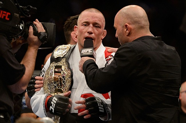 Mar 16, 2013; Montreal, Quebec, CAN; Georges St.Pierre gives an interview to Joe Rogan after defeating Nick Diaz (not pictured) in their Welterweight title bout at UFC 158 at the Bell Centre. Mandatory Credit: Eric Bolte-USA TODAY Sports