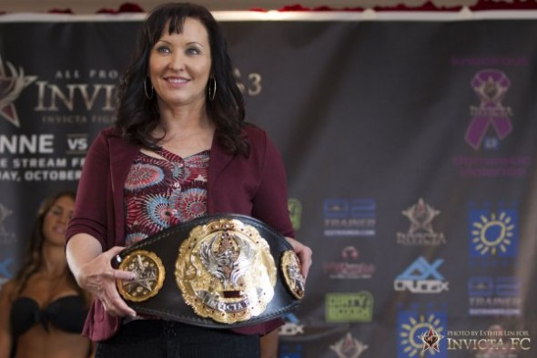 Invicta FC president Shannon Knapp holds the Invicta Atomweight championship. Photo Credit: Esther Lin-Invicta FC