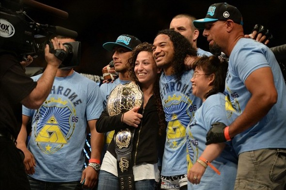 Apr 20, 2013; San Jose, CA, USA; Benson Henderson and Maria Magana poses for a photo with the rest of the team after defeating Gilbert Melendez (not pictured) during the lightweight championship bout of the UFC on Fuel TV at HP Pavilion. Mandatory Credit: Kyle Terada-USA TODAY Sports