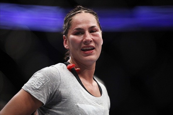 Oct 19, 2013; Houston, TX, USA; Jessica Eye (blue gloves) reacts after being defeated by decision by Sarah Kaufman (not pictured) in their women