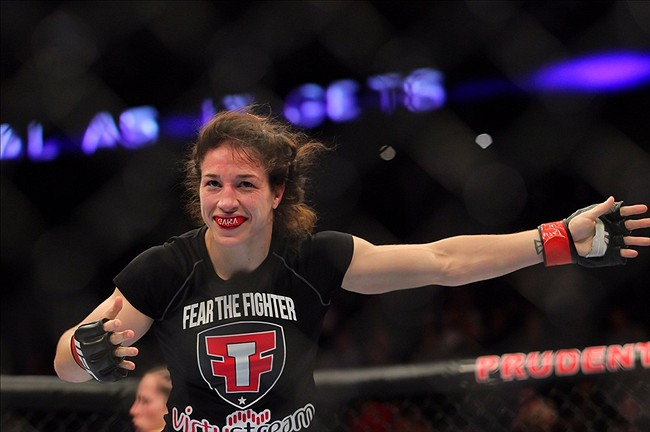 Apr 27, 2013; Newark, NJ, USA; Sara McMann (black shorts) celebrates defeating Sheila Gaff (not pictured) during UFC 159 at the Prudential Center. Mandatory Credit: Brad Penner-USA TODAY Sports