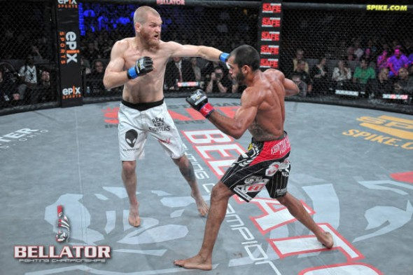 Brent Weedman (left) punches Thiago Michel (right) in the face at Bellator 66 last month. Photo via Bellator.com