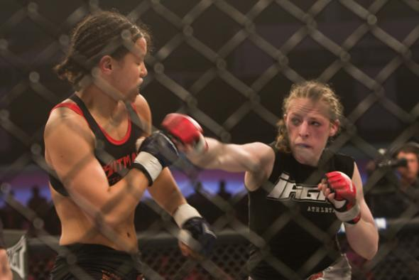 Baszler (left) in the first fight with Kaufman (right). Credit: Thomas Martinez-Sherdog.com